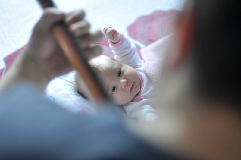 man playing guitar to baby