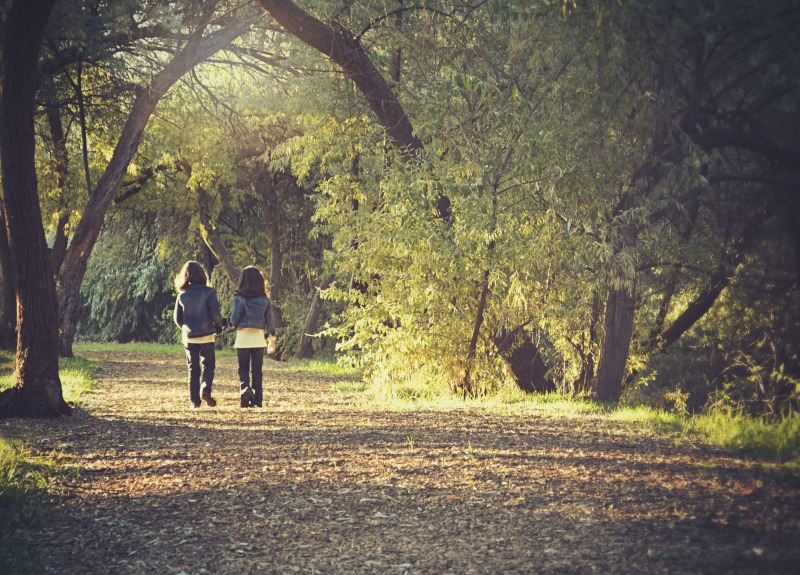 two girls walking in woods