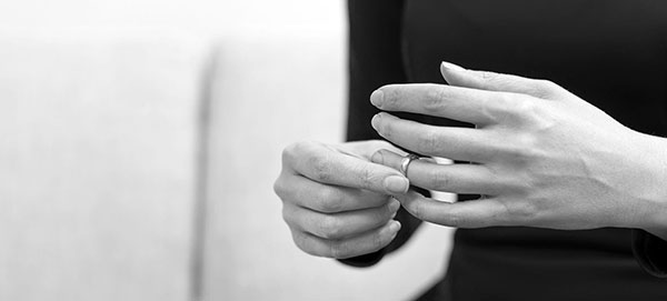 woman hands touching wedding ring